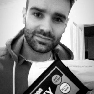 Sam charlesworth holding a tasty block in black and white