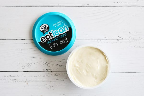 spreadable protein cheese on a chopping board