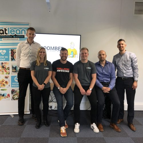 Ben Coomber sitting with the Eatlean Team