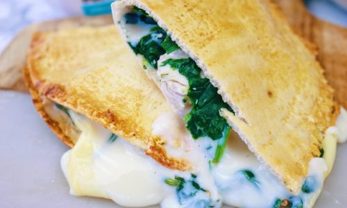 Cheesy chicken and spinach pastie cut in half