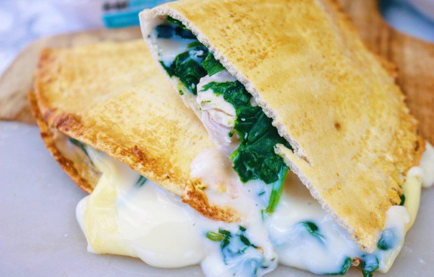 Cheesy chicken and spinach pastie cut in half