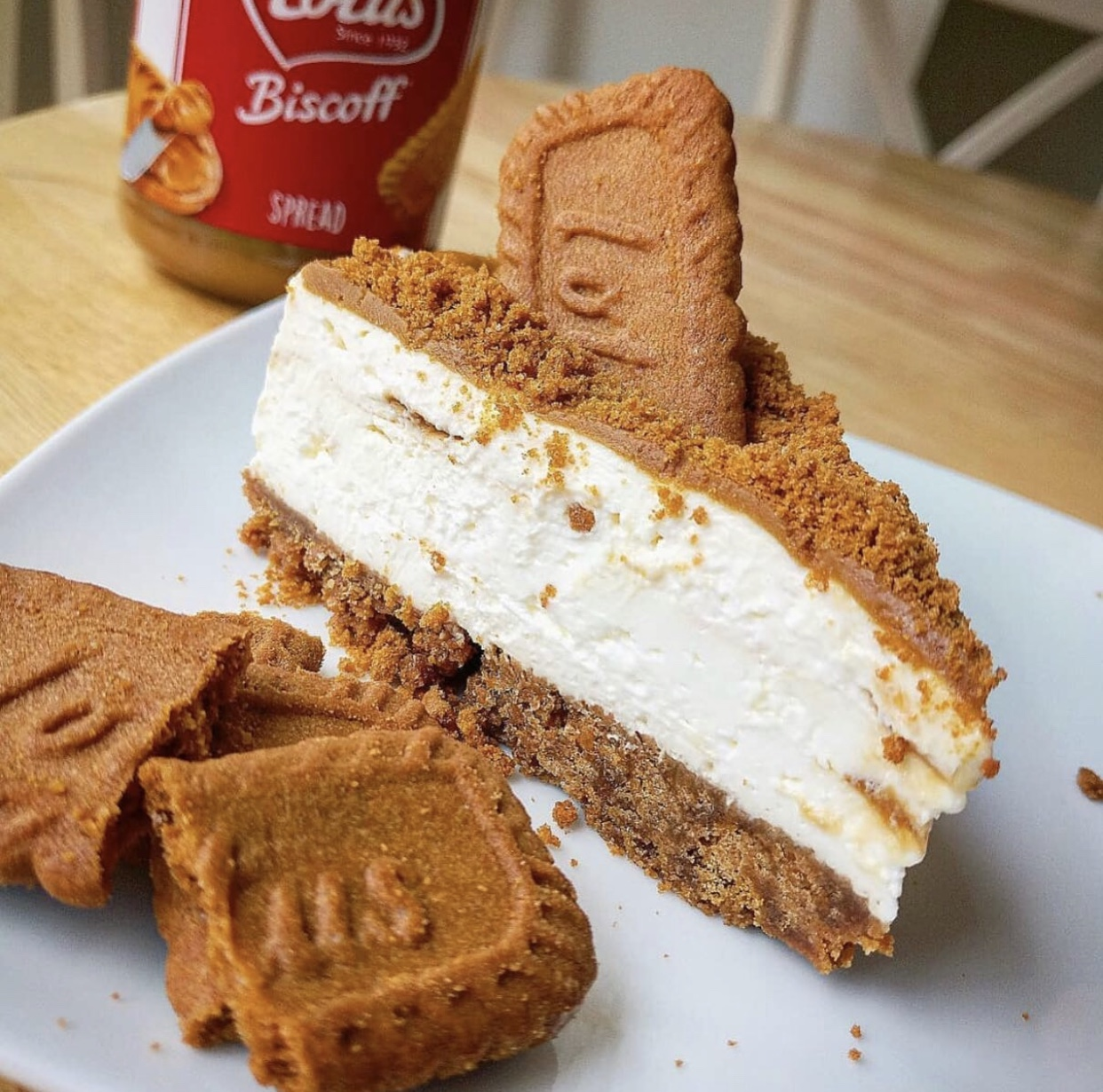 a slice of low calorie biscoff cheesecake