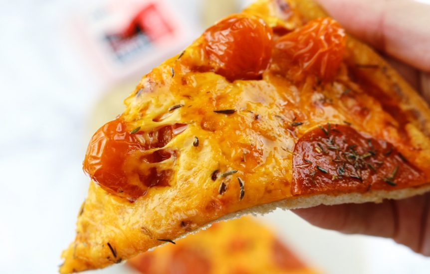 A slice of Low calorie cheese and cherry tomato pizza