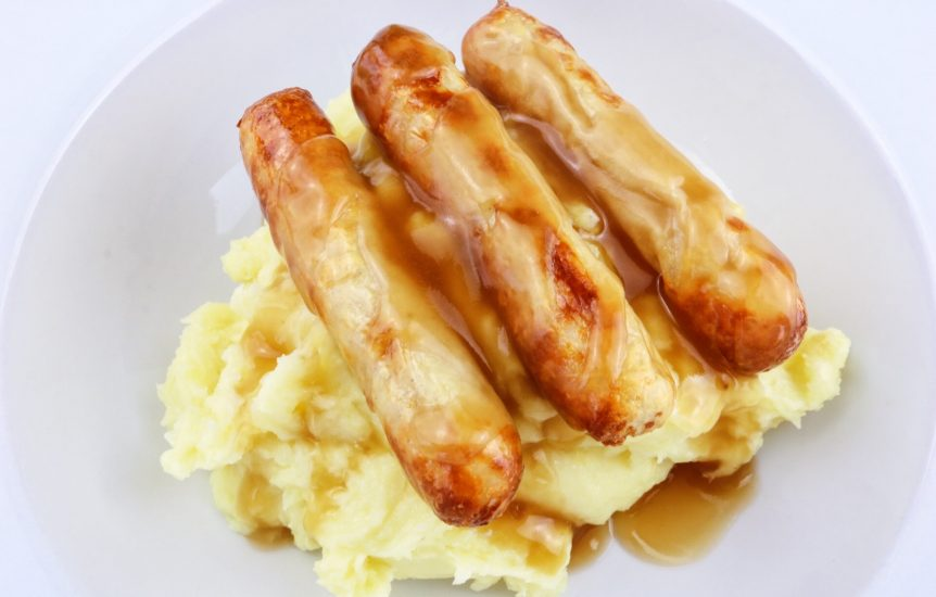 Low fat cheesy mash potato with three lean sausages on top and gravy