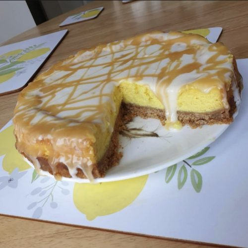 Low fat lemon drizzle cheesecake on a plate