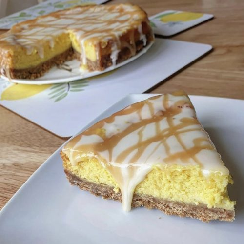 Low fat lemon drizzle cheesecake slice on a plate