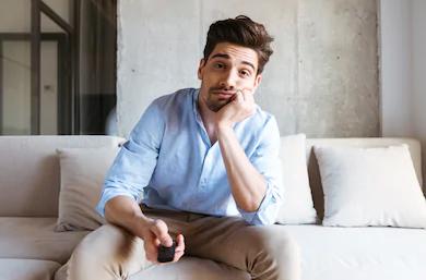 Man sat at home bored watching TV