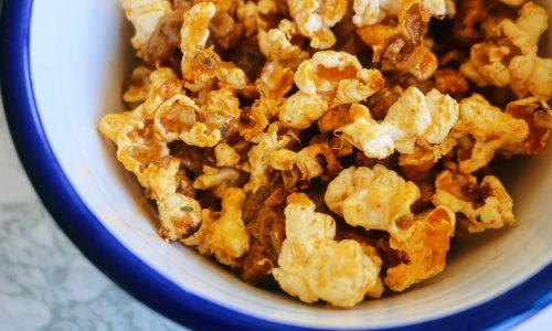 Stay at home sticky cheesy popcorn in a bowl