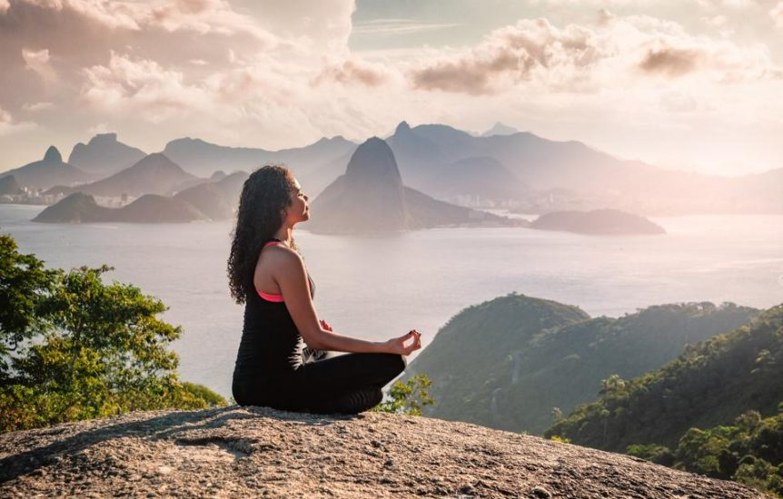 Woman Sat Meditating on a Hill